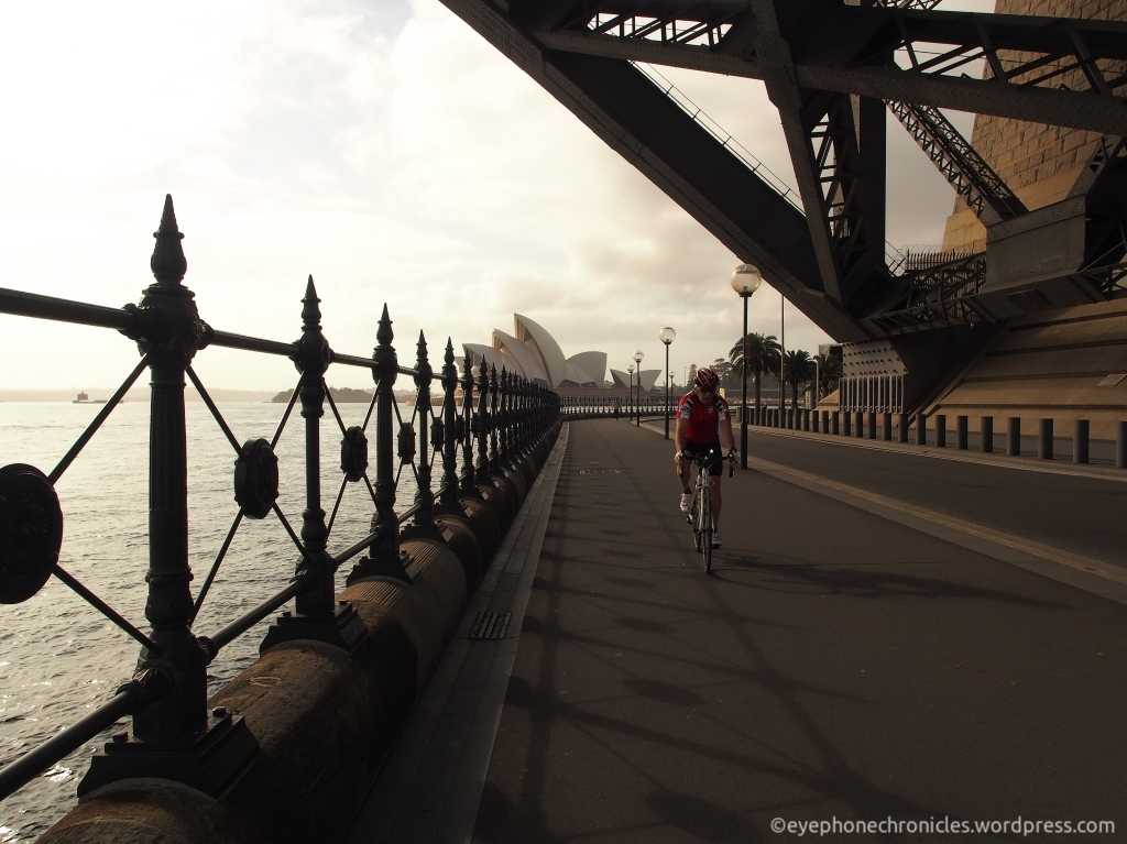 Sydney Opera House and cyclist