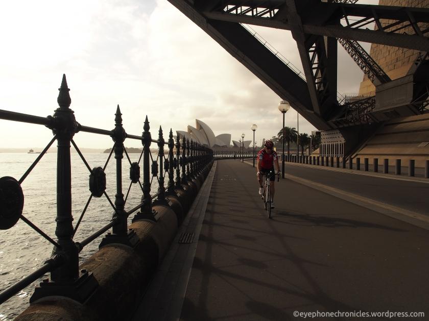 Sydney Opera House and cyclist