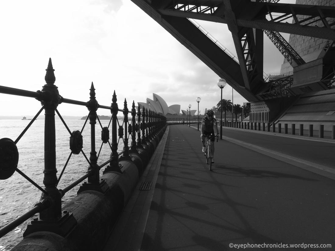 Sydney Opera House and cyclist (bw)